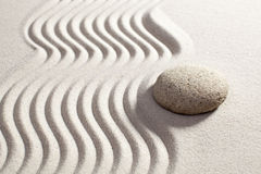 Making waves in sand for zen exercise Stock Photography