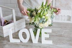 Making wedding bunch in floristry workshop. Stock Photo