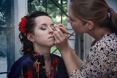 Making wedding makeup and coiffure for brunette Stock Photos