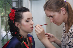 Making wedding makeup and coiffure for woman Stock Images