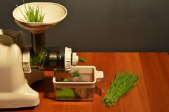 Making wheat grass juice Royalty Free Stock Photography