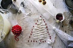 Making White Christmas sweet meringues with pomegranate Royalty Free Stock Photography
