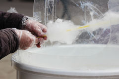 making white cotton candy in cotton candy machine Royalty Free Stock Photo