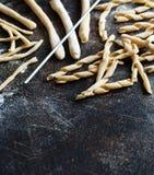 Making whole wheat flour pasta fusilli al ferro. Close up Royalty Free Stock Image