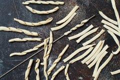 Making whole wheat flour pasta fusilli al ferro. Top view Royalty Free Stock Photography