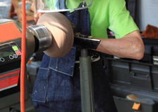 Making Wood Artifact. Artist is making wood artifact with a machine at a local fair Royalty Free Stock Photo