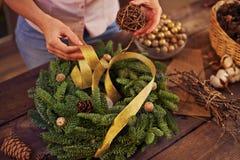 Making xmas wreath Royalty Free Stock Photos