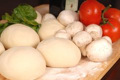 The makings for a fresh homemade pizza on a cutting board Stock Photo