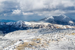 Makinoto Pass with Mt. Kuroiwa in Winter. In beautiful snowy scenery, hikers begin their treks of Japan`s Aso-Kuju National Park here, at the main gateway to Mt stock photos