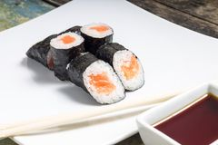 Makisushi on a plate. Seafood traditional maki sushi rolls with chopsticks Royalty Free Stock Image