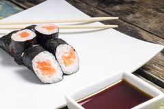 Makisushi on white plate. Seafood traditional maki sushi rolls Stock Images