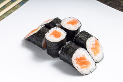 Makisushi on white plate. Seafood traditional maki sushi rolls Stock Photography