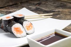 Makisushi on white plate. Seafood traditional maki sushi rolls Royalty Free Stock Image