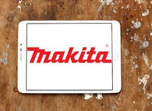 Makita Corporation logo. Logo of Makita Corporation on samsung tablet on wooden background. Makita is a manufacturer of power tools Royalty Free Stock Image