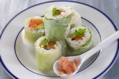 Makizushi. Delicious sushi rolls on white plate with chopsticks Royalty Free Stock Image