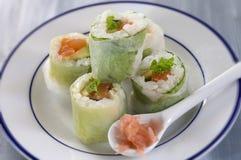 Makizushi. Delicious sushi rolls on white plate with chopsticks Royalty Free Stock Image