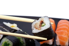 Makki sushi. Maki Sushi with red nigiri on the background Royalty Free Stock Photo