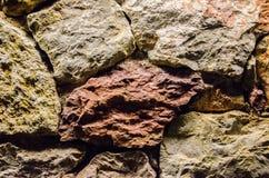 Makro av den naturliga olika bakgrunden för vägg för färggranitsten Royaltyfria Bilder