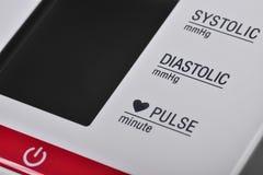 Makro av ett hjälpmedel för att mäta blodtrycket Arkivfoto