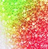 Makro av röda och gröna bubblor Arkivfoton