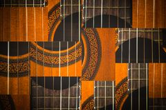Makro av radmodellen för akustisk gitarr arkivbilder