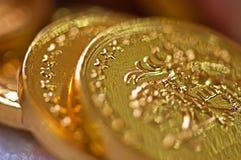 Makro der Goldmünzen Stockfotografie