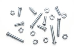 Makro einer kleinen Sammlung Eisen-Schrauben und Bolzen in einem Whitebox Lizenzfreies Stockfoto