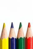 Makro för fyra färgad blyertspennor Arkivbild
