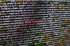 Makro- fotografia ekran komputerowy z programa źródła kodem i podkreślający WYMAZUJE TWÓJ dane inskrypcję w środku obraz stock