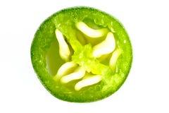 Makro- pokrojeni zieleni gorącego chili pieprze odizolowywający na białym tle obrazy royalty free