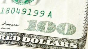 Makro som är nära upp av dollarräkningen för USA 100 Arkivbild