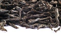 Makro som skjutas av ett högkvalitativt svart te på vit bakgrund Bakgrundsslut f?r svart te upp Picture kan anv?ndas som en bakgr arkivfoto