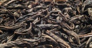 Makro som skjutas av ett h?gkvalitativt svart te Bakgrundsslut f?r svart te upp Picture kan anv?ndas som en bakgrund Bakgrund av  royaltyfria bilder