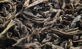 Makro som skjutas av ett h?gkvalitativt svart te Bakgrundsslut f?r svart te upp Picture kan anv?ndas som en bakgrund Bakgrund av  arkivfoto