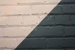 Makro- strzał biel i zielony błękit malował ściana z cegieł Obraz Stock