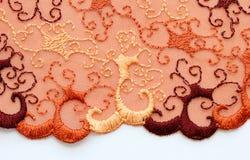 Makro- strzał czerwieni i pomarańcze tekstury koronkowy materiał Zdjęcie Royalty Free