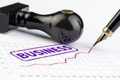 Makro- strzał stemplowy biznes na narastającym wykresie Zdjęcie Royalty Free