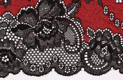 Makro- strzał czerwieni i czerni koronkowa tekstura Fotografia Royalty Free