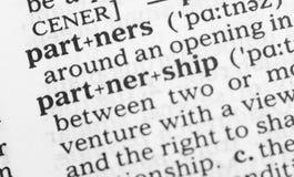 Makrobild av ordbokdefinitionen av partnerskap Royaltyfri Foto