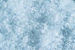 Makrobild av snöflingor vinter för blåa snowflakes för bakgrund vit Arkivbild