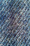 Makrobild von Blue Jeans, Denimbeschaffenheitshintergrund Stockbild
