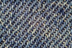 Makrobild von Blue Jeans, Denimbeschaffenheitshintergrund Lizenzfreies Stockfoto