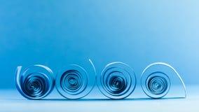 Makroen abstrakt begrepp, bakgrundsbild av blått papper röra sig i spiral på pappers- bakgrund Royaltyfria Bilder