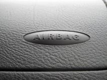 Makroen av en airbag undertecknar på en instrumentbräda Royaltyfria Foton