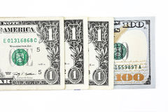Makroen sköt av en ny 100 dollarräkning och en dollar Royaltyfri Foto