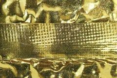 Makrofoto der Goldfolie von der Verpackung des chinesischen Tees stockfotos