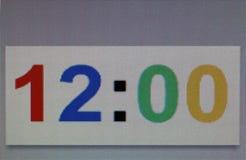 Makrofotoet av numret är tolv minuter för nolla-`-klocka noll på royaltyfria bilder