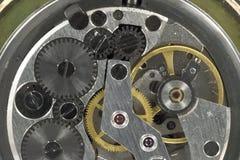 Makrofotografiet av mekanismen av klockan för gammal hand arkivfoto