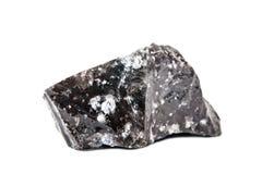 Makroschießen des natürlichen Edelsteins Das rohe Mineral ist Obsidian, Indonesien Getrennte Nachricht auf einem weißen Hintergru Lizenzfreies Stockfoto