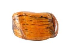 Makroschießen des natürlichen Edelsteins Mineraltigerauge, Südafrika Gegenstand auf einem weißen Hintergrund Stockbild